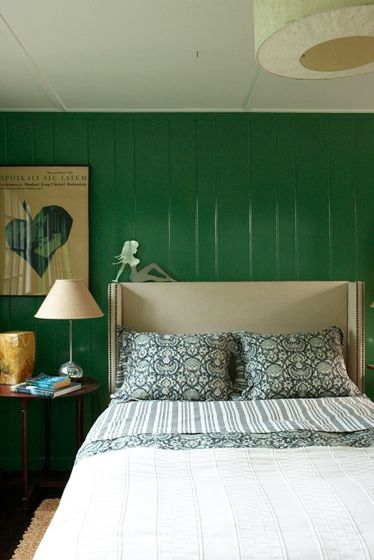 A very green bedroom. Color is good for you-health and relaxation. The rest of the room? Not so much.