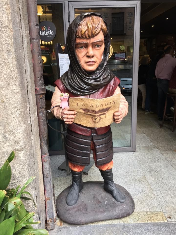 Tyrion was here.... Izzy about to go into the bar (La Abadia). Hope there is not a height restriction to shuffle up to the counter.   Toledo, Spain (15-May-2017)