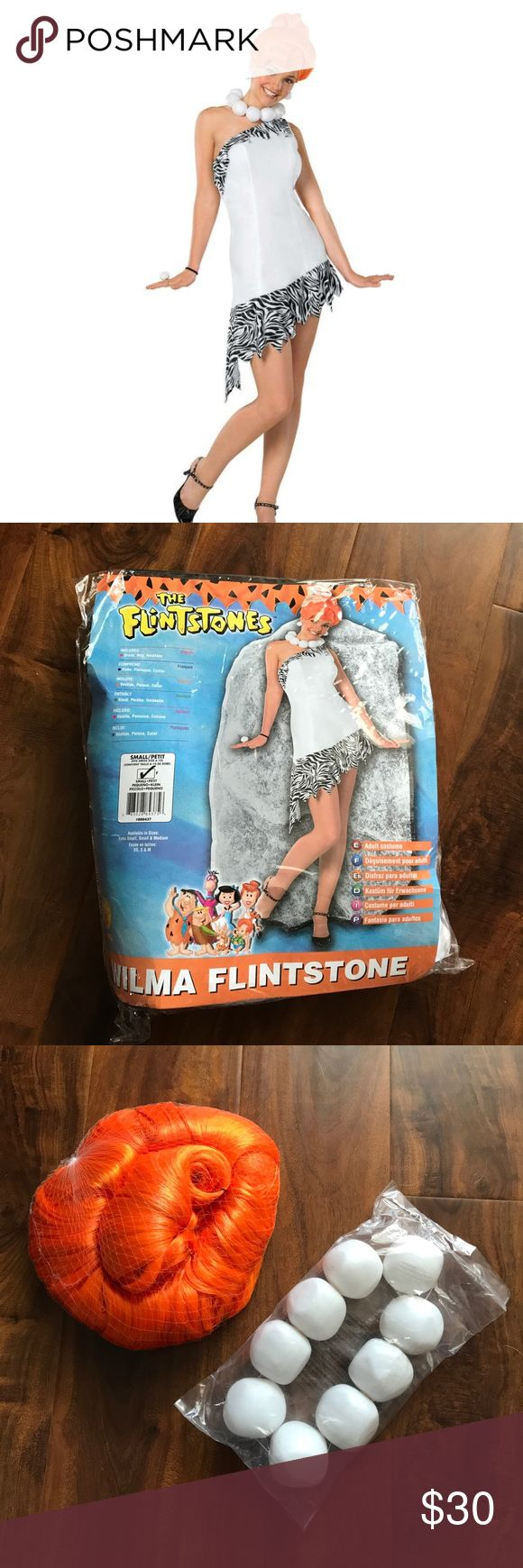 """Wilma Flinstone Halloween Costume Brand new in the bag! I ordered online without measurements and failed to read the fine print that the costume was non-refundable. Wig and necklace are still unopened in their packaging, and the dress was only tried on once. Size Small but would probably best fit a Medium well also. Measurements across the bust: 17"""", across the hips: 18"""". 100% polyester, soft material and super cute. Dresses One Shoulder"""