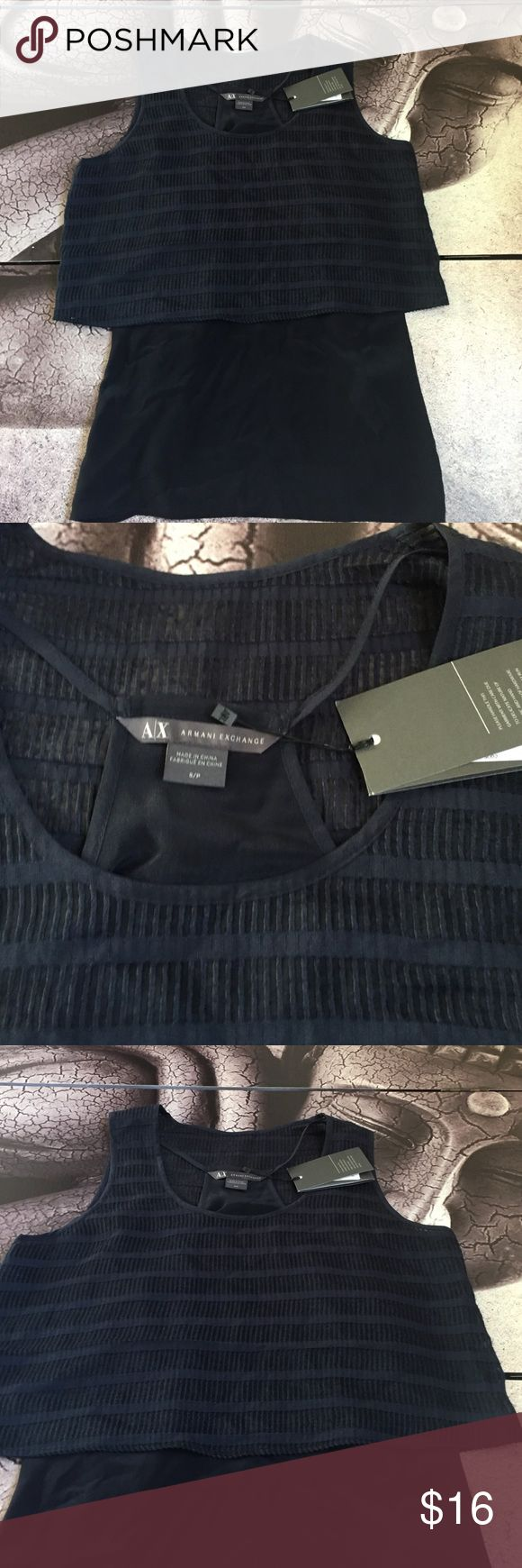 Armani Exchange Two in One Top Cute Armani Exchange top in navy. Includes tank top and outer shell. Shell: 76% Rayon 24% nylon. Lining: 100% Mulberry Silk. Armani Exchange Tops Blouses