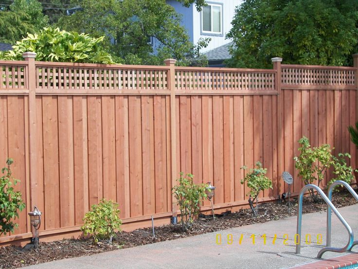 Redwood fence with lattice top backyard pinterest we for Using lattice as fencing