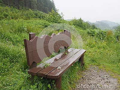Rain-soaked bench facing Ben Venue. Taken on a rainy day in July 2015 above Loch Ard in the Trossachs National Park, Scotland, during an exceptionally cold, wet summer.