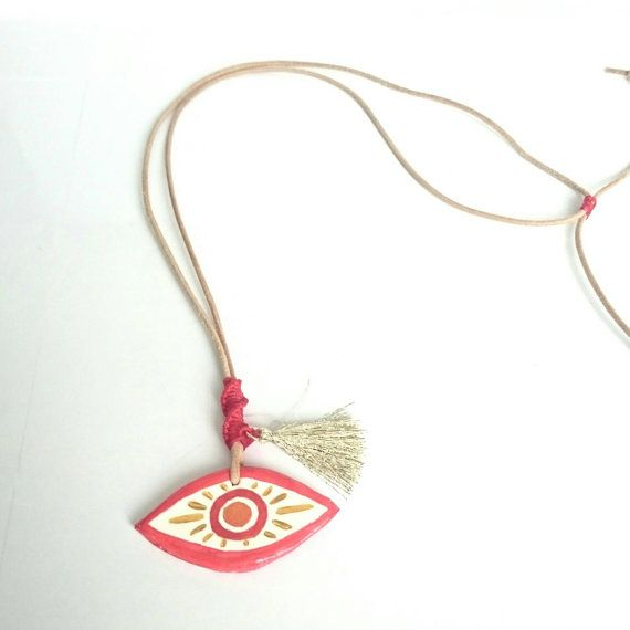 Check out this item in my Etsy shop https://www.etsy.com/listing/291150179/red-boho-chic-evil-eye-pendant-polymer
