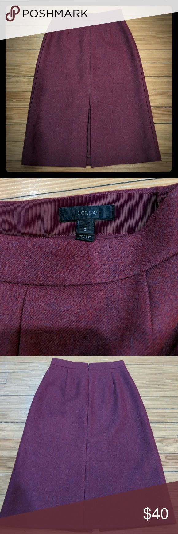 J. Crew A line midi skirt in double serge wool Cranberry color size 2  This A-line below-the-knee skirt in our sleek and substantial double-serge wool has all the makings of your new favorite layer for fall. A higher waist and a slim cut through the hips give it a super-polished look, while a flirty front slit keeps things playful.  Wool.  Back zip.  Lined.  Dry clean.  Import.  Online only.  Item C8790. J. Crew Skirts