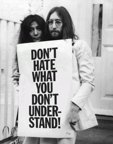 Yoko Ono & John Lennon, with a message that's as relevant today as it was when the photo was taken