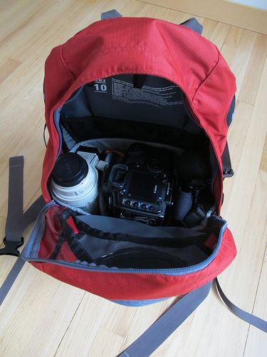 This article talks about using a regular backpack along with a camera bag insert to protect camera gear while hiking.