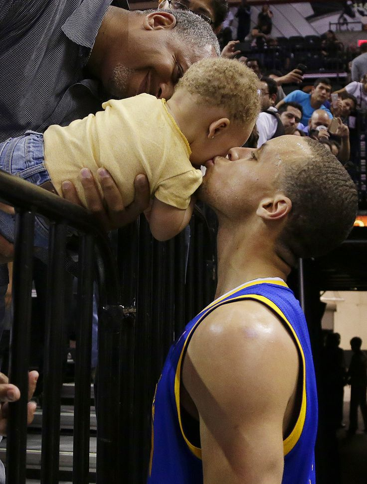 Kiss the baby Golden State Warriors Stephen Curry, right, kisses his daughter, Riley, following their win over the San Antonio Spurs in Game 2 of a Western Conference semifinal NBA playoff series, Wednesday, May 8, 2013, in San Antonio. Golden State won 100-91. (Eric Gay/AP) GALLERY: NBA Playoffs: May 8
