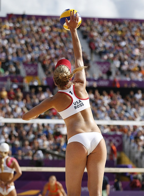 London Olympics Beach Volleyball Women    United States' April Ross serves during a beach volleyball match against Spain's