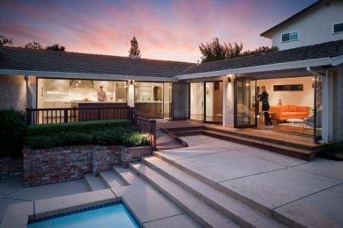 Nearly all the exterior walls here open onto the backyard, turning a segmented home into one open, convivial space where the outdoors are as important as the indoors.