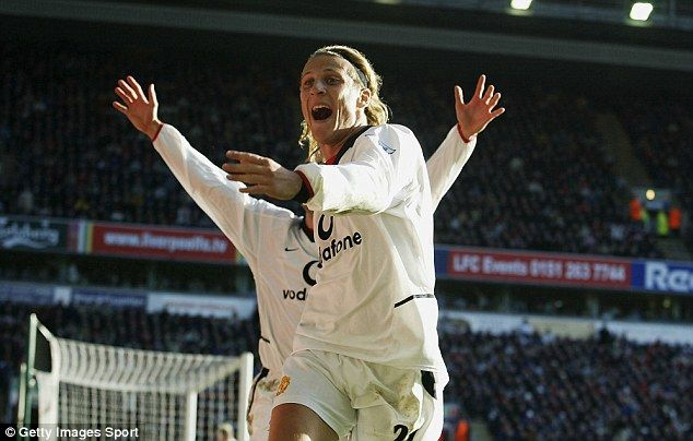 United supporters chant 'Diego, Diego' in reference to their former striker Diego Forlan