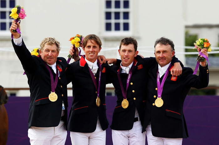 Gold medalists Nick Skelton, Ben Maher, Scott Brash and Peter Charles of Great Britain celebrate on the podium during the medal ceremony for the Team Jumping on Day 10 of the London 2012 Olympic Games at Greenwich Park on August 6, 2012 in London, England.