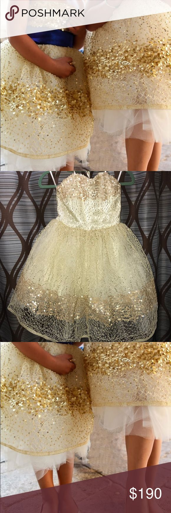 """DOLORIS PETUNIA GOLD CONSTELLATION DRESS 0 2 Jaw dropping gorgeous dress by Dolores Petunia Etsy. I'm 5'1"""" 107 lbs. Worn once for 2 hours. Fits 26"""" or 27"""" waist, 34B bra Sash not included. The dress is gold & white. Pair with any color sash for different events! Perfect for petite woman or a junior bridesmaid / pageant. Worn by Vivienne Pitt, Heidi Klum's daughter + Jessica Alba's daughter! Gold sequins tulle strapless or wear w/ straps. Neckline is straight not sweetheart. Sz 0 / 2 xs…"""