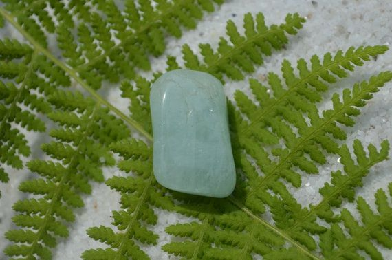 Attractive natural tumbled aquamarine stone tie tack. The natural tumled aquamarine has a fantastic transparent color, with a great oval shape.