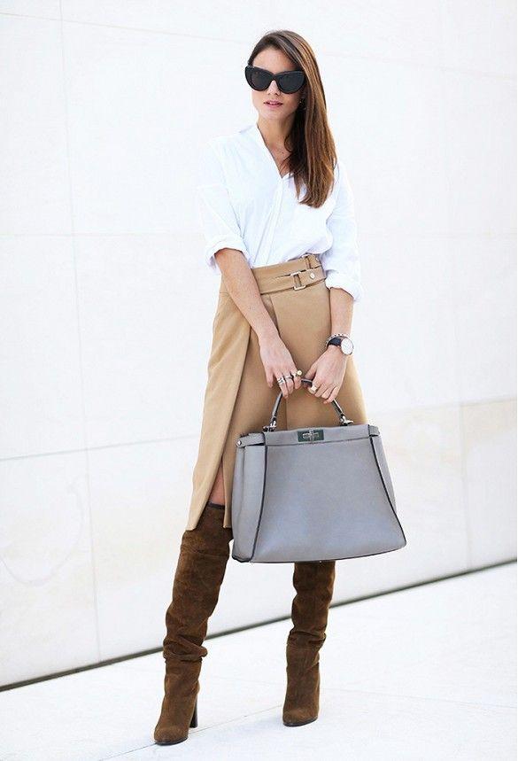 Zina Charkoplia of FashionVibe wears a button-down shirt, khaki skirt, knee-high suede boots, cat-eye sunglasses, and a gray Fendi bag