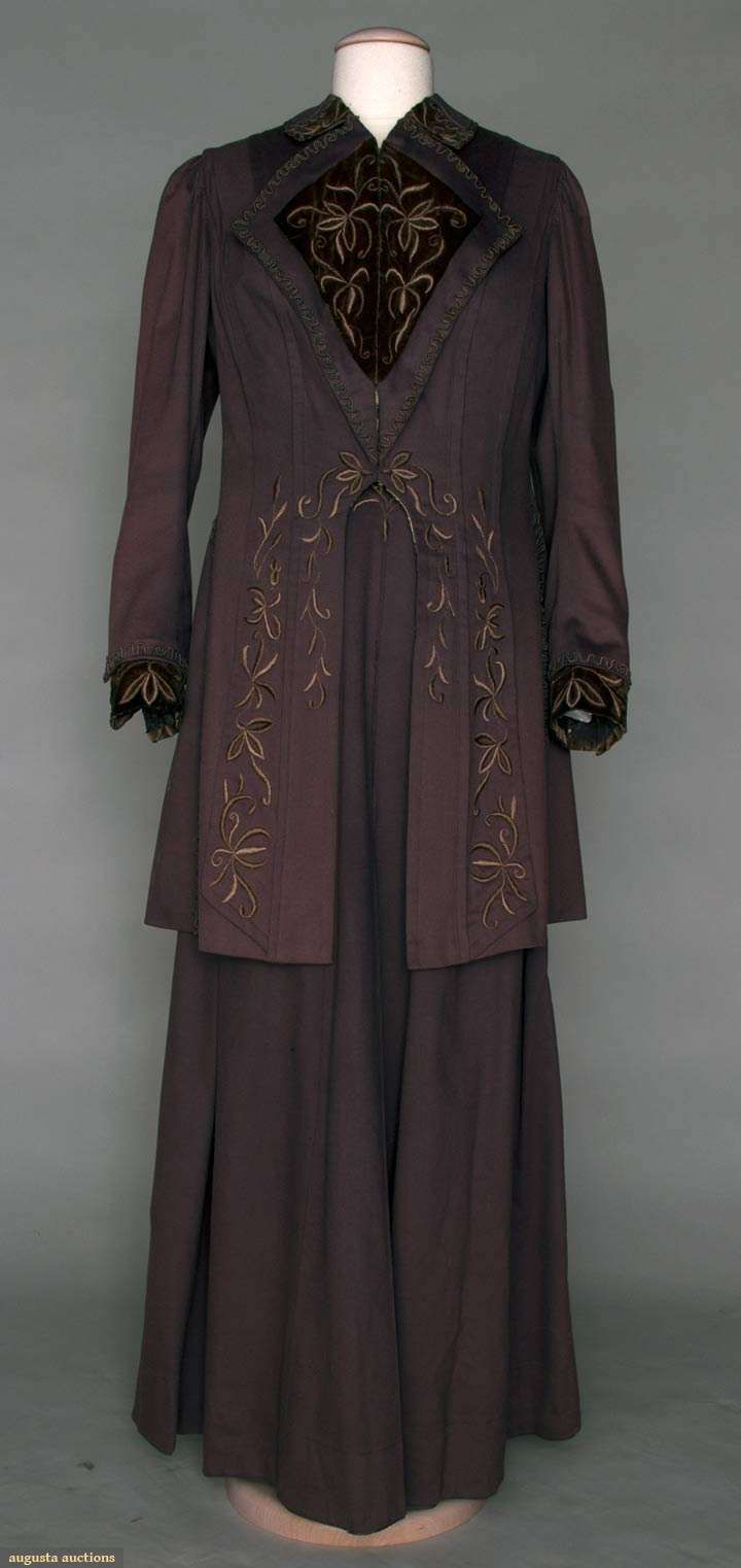 "EMBROIDERED WALKING SUIT, 1905-1908. Lot: 348, November 2, 2011, New York City. Dusty purple wool 3/4 L jacket & slightly trained skirt, collar, cutaway jacket front & cuffs embroidered in taupe silk stylized florals, B 42"", W 28"", Skirt L 41"", Jacket L 32"", (jacket lining shattered) very good. Brooklyn Museum.     Price Realized: $ 330.00      Category: Womens      Era: 1890-1920      Condition: Very Good"