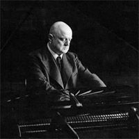 Jean Sibelius playing the piano