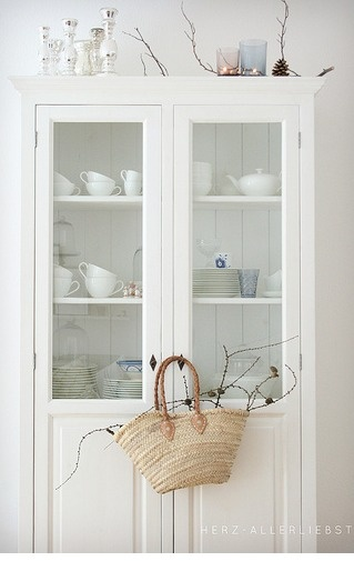 Dining room idea: This cabinet in the middle of the wall with lower cabinets on either side.