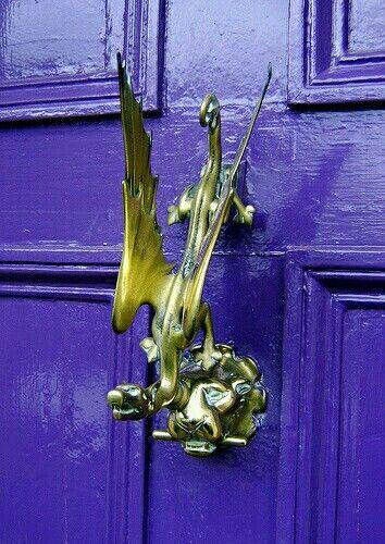 Winged door knocker