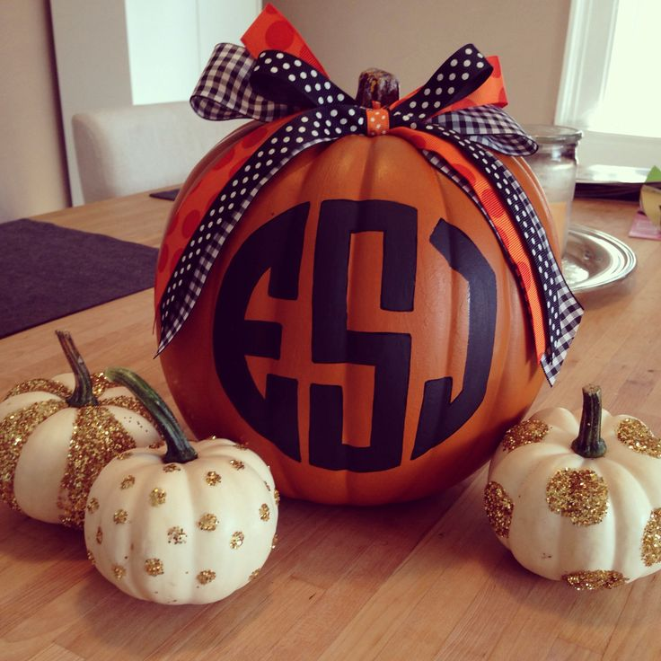 Another monogrammed pumpkin, embellished with ribbon. This one is painted - with little painted baby pumpkins. :-)