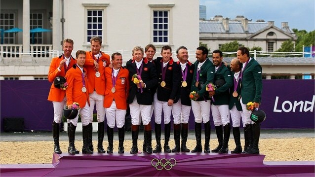 Great Britain (C) celebrates with their gold medals, the Netherlands (L) with their silver medals and Saudi Arabia (R) with their bronze medals on the podium during the medal ceremony for Team Jumping on Day 10 of the London 2012 Olympic Games at Greenwich Park