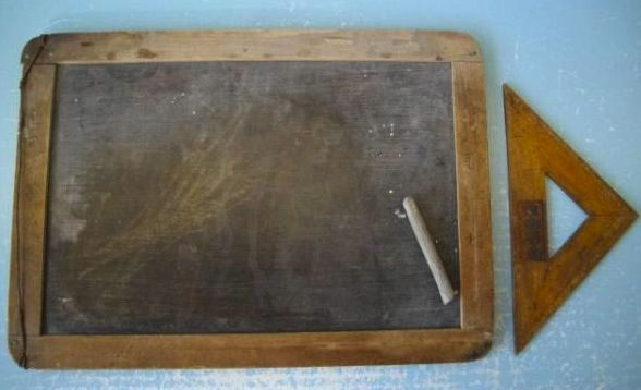 A prewar Japanese child's school slate board, with original stone type marker, and wooden square