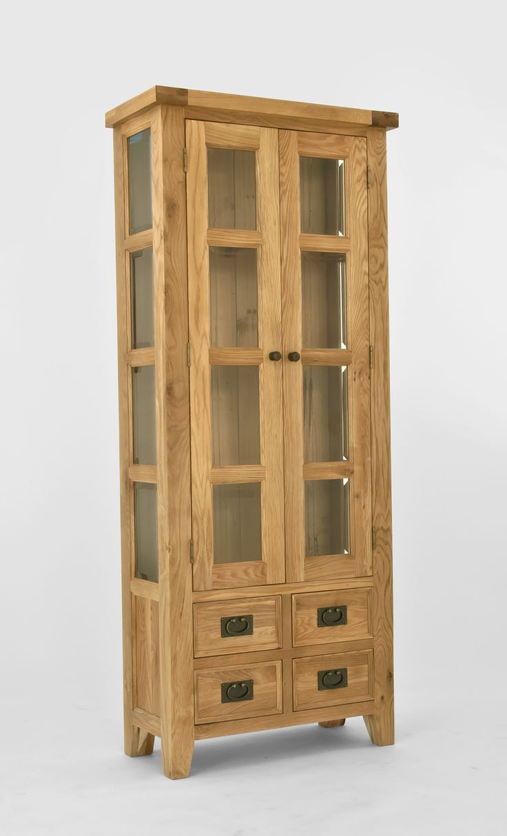 Chiltern Oak Small Display Cabinet Chiltern Oak Small Display Cabinet has two glass fronted doors and four drawers offering many display and storage options. Crafted from North American Oak using traditional methods including dovetail  http://www.MightGet.com/january-2017-13/chiltern-oak-small-display-cabinet.asp