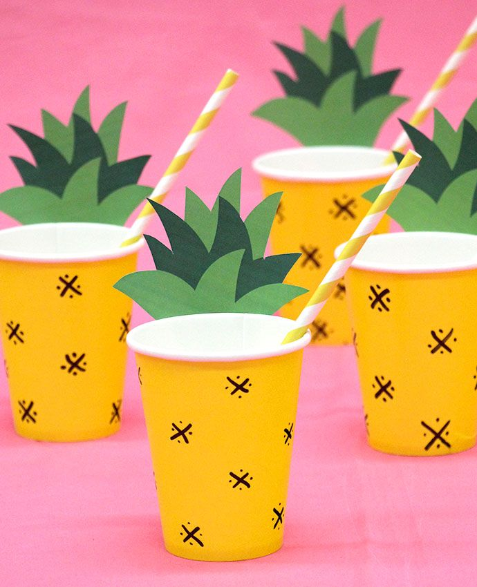 DIY pineapple cups    How cute are these pineapple cups? Perfect for serving cocktails or mocktails, all you need is a black marker pen and our free printable pineapple leaves to give these plain yellow cups a tropical transformation. Then fill a cup with your favourite cocktail and pop in a stylish yellow and white striped straw.