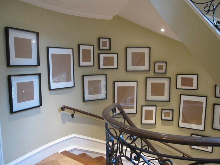 Hang the frames and then find pics to fill them.  Like this idea.