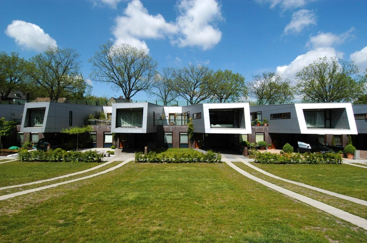 Named 'the cyclops' due to its futuristic look, NIO Architecten designed a set of soundbarrier houses that use cantilevers and hollow features to give the residents something out of the ordinary http://www.archello.com/en/project/cyclops #Architecture #Design