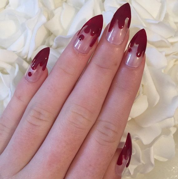 Handmade stiletto nails with blood drips and super glossy top coat. Comes with glue