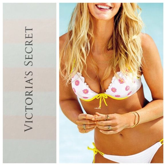 Victoria's Secret push up halter top Victoria's Secret padded push up halter top, size 36C.  Bright pink sequin hibiscus flowers on white with yellow straps and a ruffle on the cups.   EUC, Worn once.  Top only.  Model pic from Victoria's Secret website to show fit. Victoria's Secret Swim Bikinis