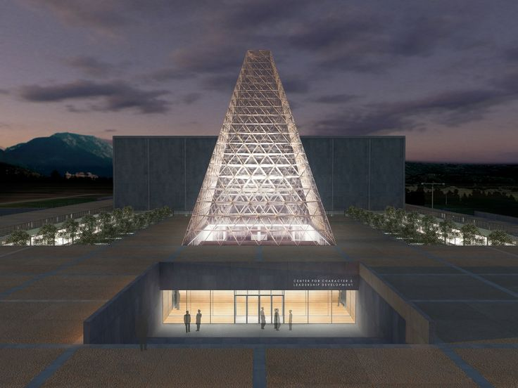 The US Air Force Academy has white lights shining on the architecture making it look as if its never ending into the sky.