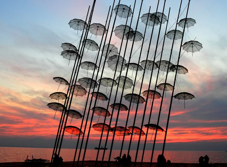 Umbrellas at sunset Photo by Georgios Vlachos -- National Geographic Your Shot
