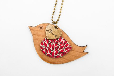 This gorgeous little birdie pendant is laser cut from Alder wood, embellished with a gorgeous little love pendant, and screen printed Japanese mulberry  paper then sealed.Pendant measures approx 6cm, chain is 75cm antique brass with lobster clasp.