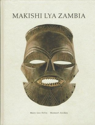 """18 MAKISHI  LYA  ZAMBIA Mask characters of the upper Zambesi peoples Masken - Charaktere der Völker am Oberen Sambesi   Felix, Marc L. / Jordan, Manuel (1998). Makishi Lya Zambia. München: Fred Jahn.  Condition: Fine (approaches the condition of """"As New""""). The book has been opened and read, but there are no defects to the book, jacket or pages."""