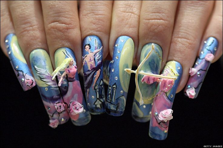 A competitor shows her nails in Tokyo
