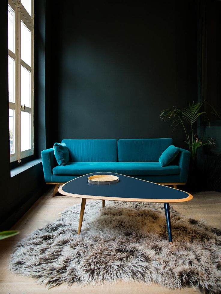 cool peacock hues juxtaposed with dark walls + a neutral textured rug