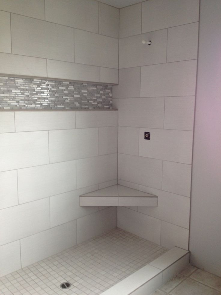 """Beautiful large profile tiles really enhance the space of a walk in shower.   Linen White 12x24 GL02 5/8"""" Linear Accent  www.colortilesalem.com"""