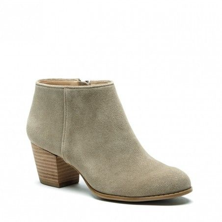 A must-own, soft green ankle bootie crafted from luxurious suede