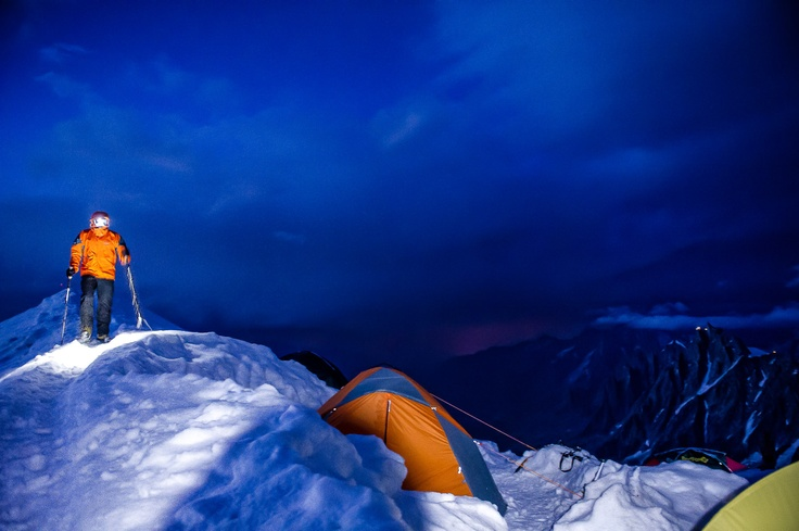 A base camp at the summit of Aiguille Gouter as seen during stormy summer night!