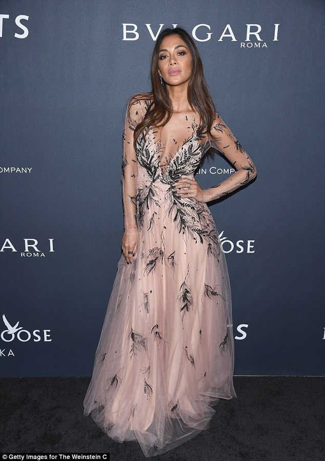 Turning heads: The former Pussycat Doll, 38, stunned in a semi sheer floor-length gown as ...