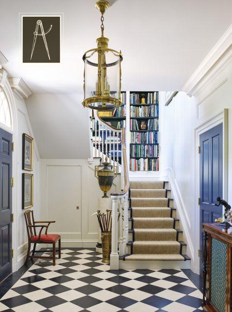 Sisal stair runner; bookshelves on stair landing; House Tour: Birmingham Beauty - black and white checkerboard floor in the entry - black or navy door.