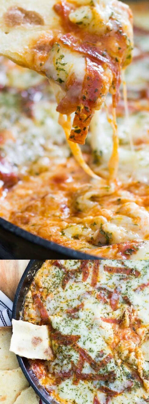 """This Extra Cheesy Pepperoni Pizza Skillet Dip from Take Two Tapas tastes just like your favorite pizza… just in a delicious dip! It's basically the BEST dip EVER with it's hot, melty, super cheesy goodness that gets paired with a thin crust pizza crust that is cut into """"chips"""" that are perfect for scooping!"""