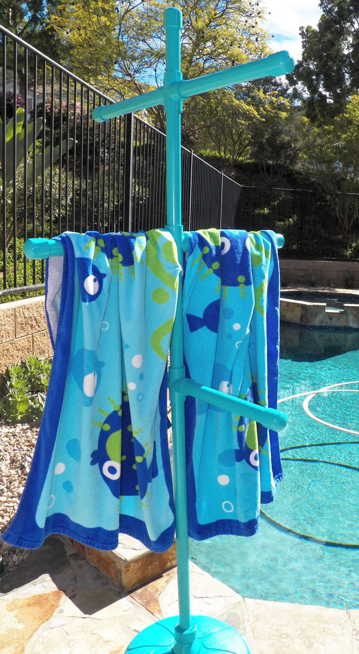 Completed 03/14!  Poolside towel tree from PVC pipe and a $7 plastic umbrella stand
