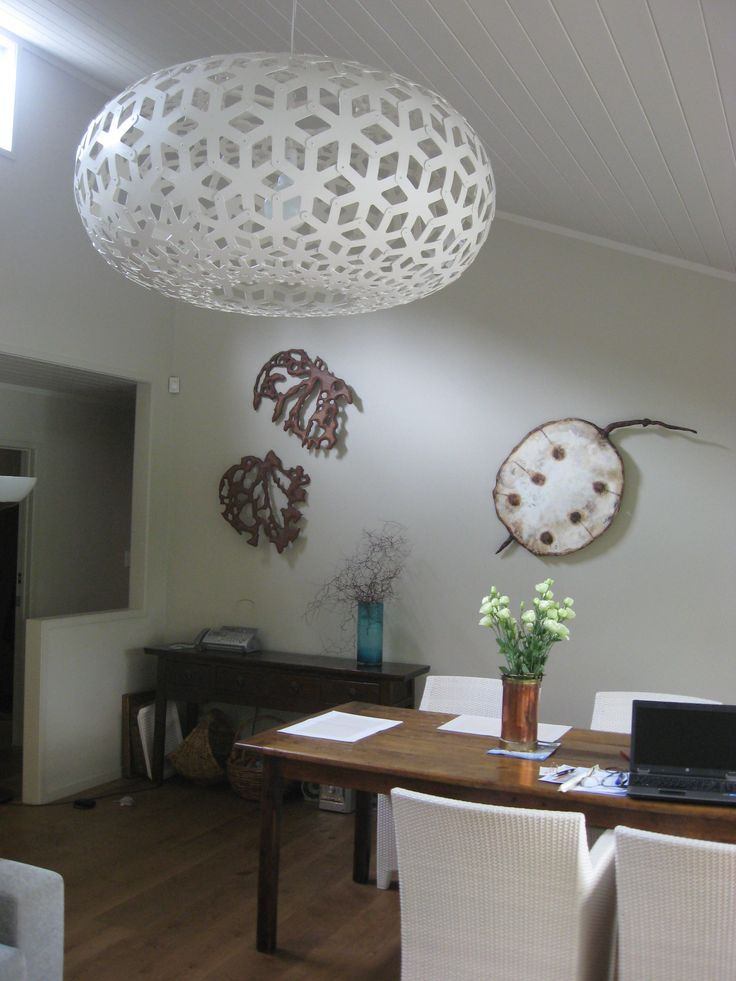 Spotted .. 3 of my carvings with a David Trubridge light. Looking fabulous together if I may say so myself. Carved Honesty Pod and Kawakawa leaves.  What do you think ? Is this a good example of Nature's form, surface and shadow in a home environment ? www.lizmcauliffe.com