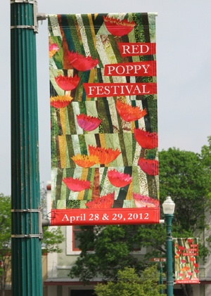 A red poppy quilt by artist Judith Shriner is featured in the publicity poster and street banners for this year's Red Poppy Festival in Georgetown, Texas. Shriner's quilt was selected as the best red poppy artwork in the annual art contest for the festival. The quilt will be on display at the Visitor Center through the weekend of the Red Poppy Festival April 28 – 29. from news.georgetown.org