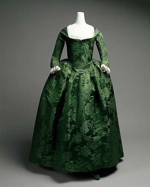 Ensemble c. 1775  American Silk This dress is considerably less gaudy for years than continental and English clothing of the period. Yet, it is not lacking in sumptuousness. Rather, the green Spitalfields damask, attributed to Anna Maria Garthwaite about 1743-45, is richly displayed. One could argue that the relative simplicity engenders more delight in the dress's inherent voluptuousness. The outfit includes matching shoes. Metropolitan Museum 2