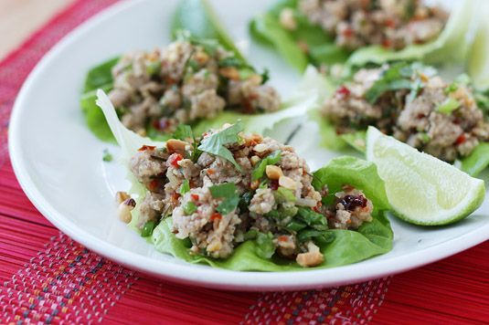 Spicy Chicken Laab Salad served on butter lettuce leaves and sprinkled with coriander and crushed peanuts