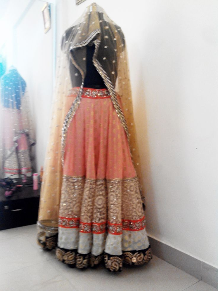 peach color elegant ghaghra choli for your special occasion..for inquiry contact on 9225061030