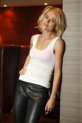 Rachael Taylor in a simple white tank and black leather pants. She looks amazing in everything and anything,